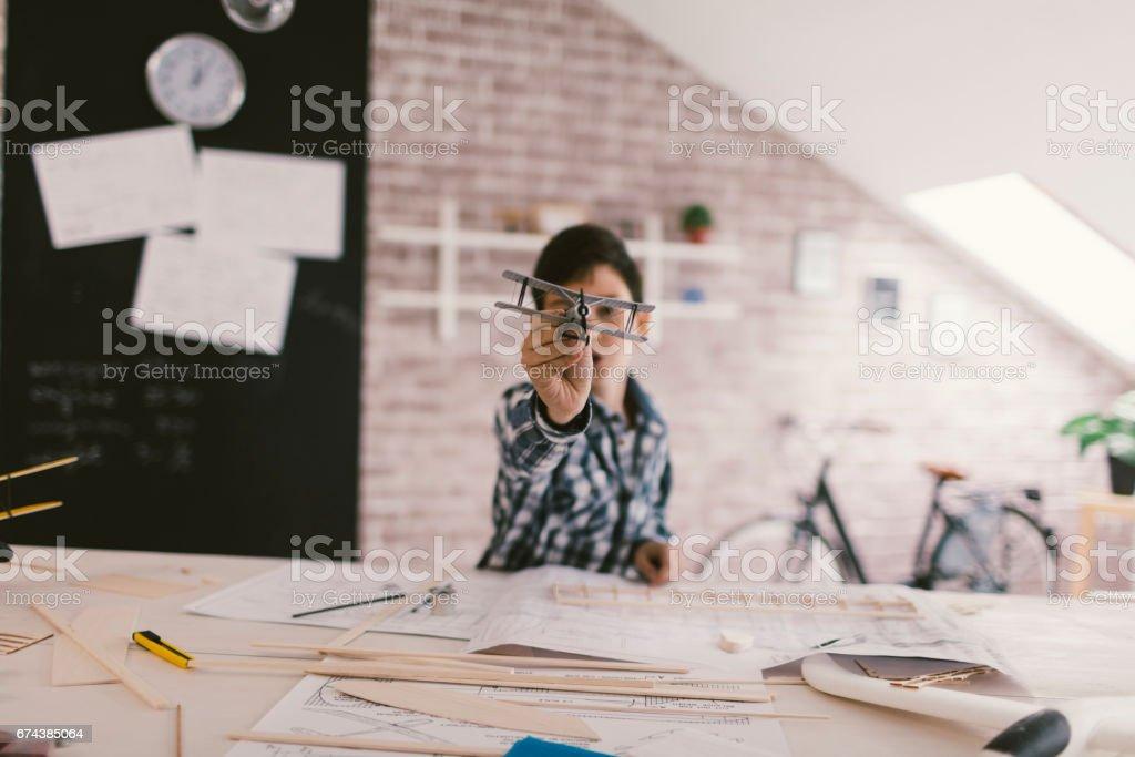 Boy making toy plane stock photo
