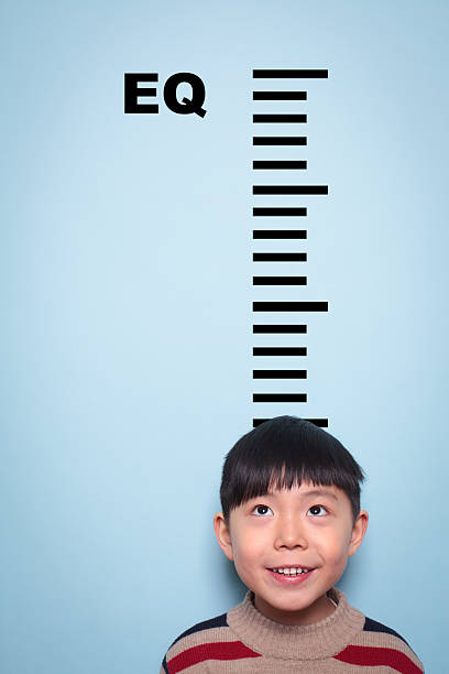 boy measuring emotional intelligence - height measurement stock photos and pictures