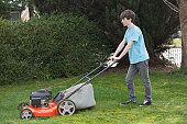People cutting grass with brush cutter outdoor