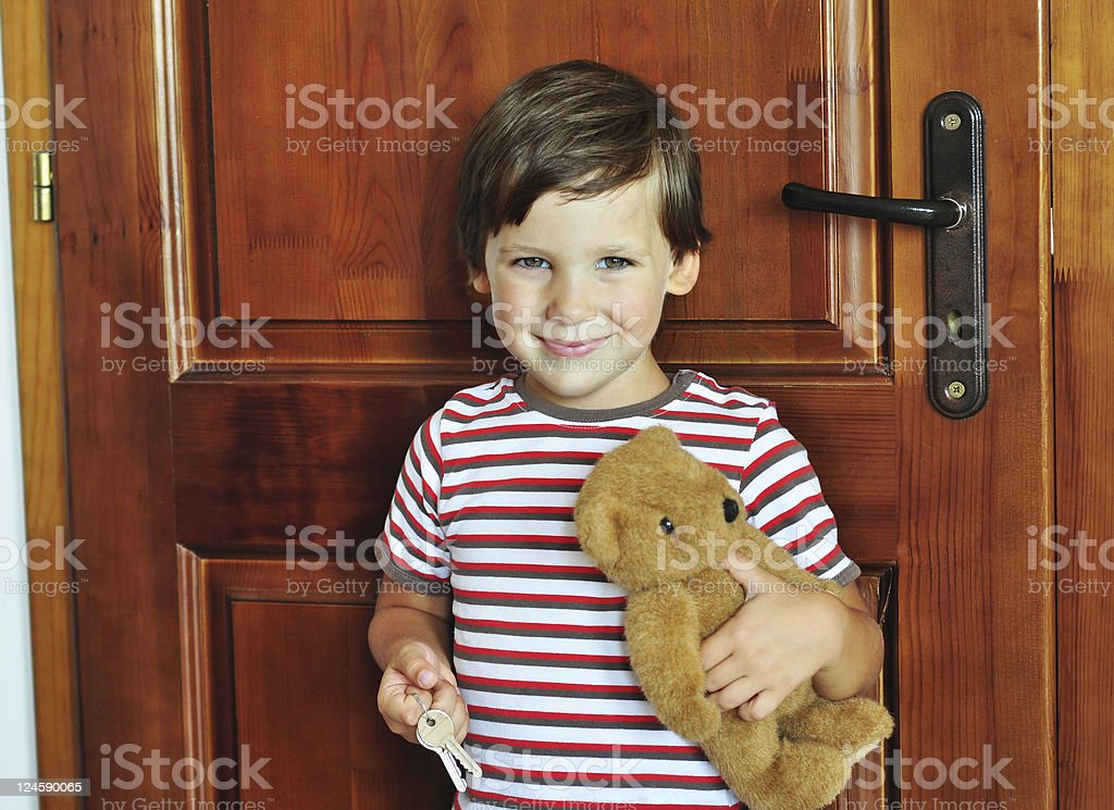 Boy near the door stock photo