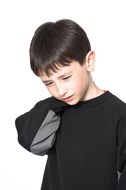 boy neck pain stock photo