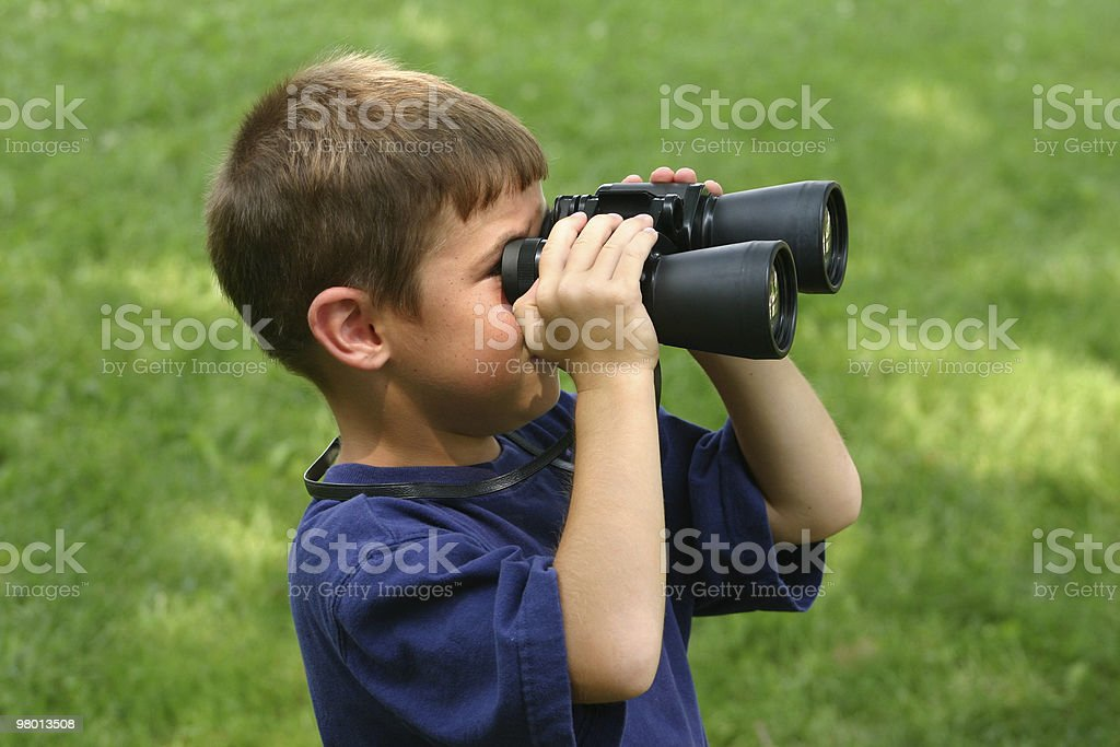 Boy Observing with Binoculars royalty-free stock photo