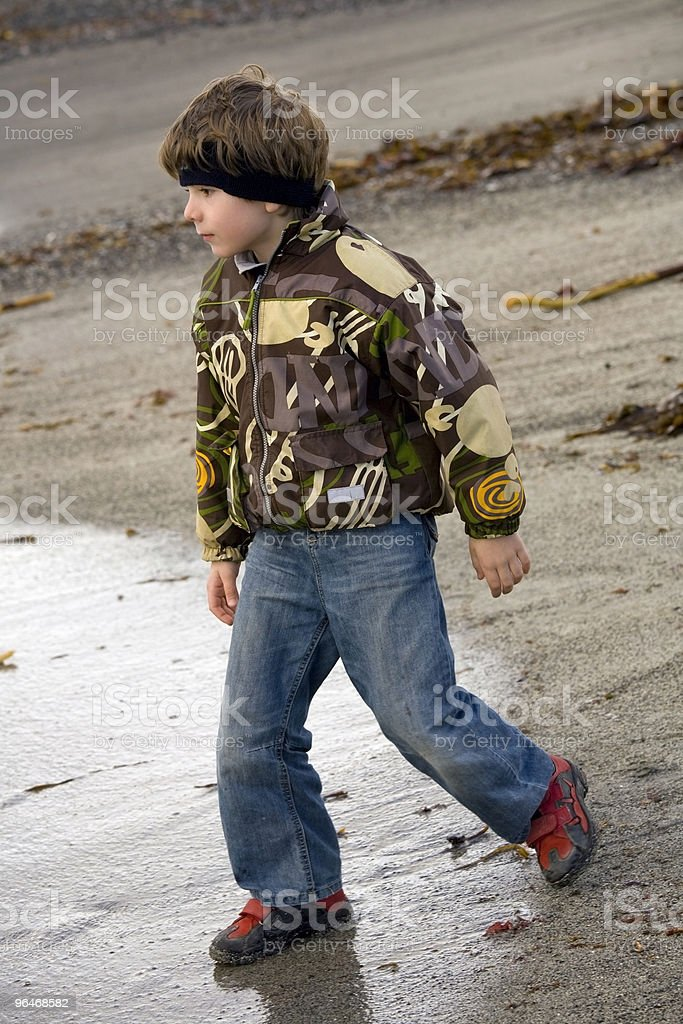 Boy on a background of the seashore royalty-free stock photo