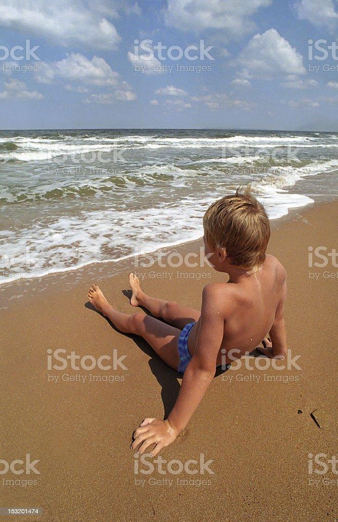 boy on a beach royalty-free stock photo