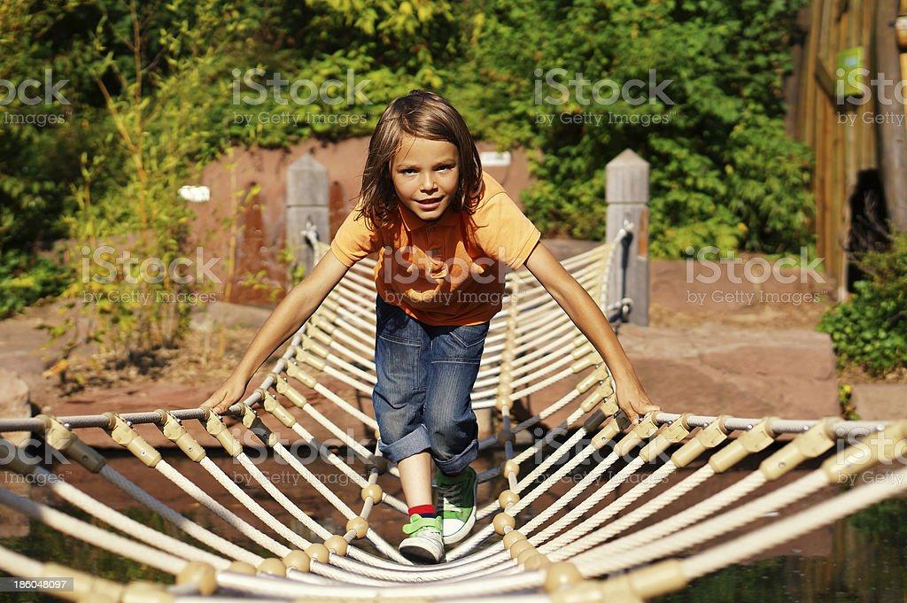 Boy on a bridge stock photo