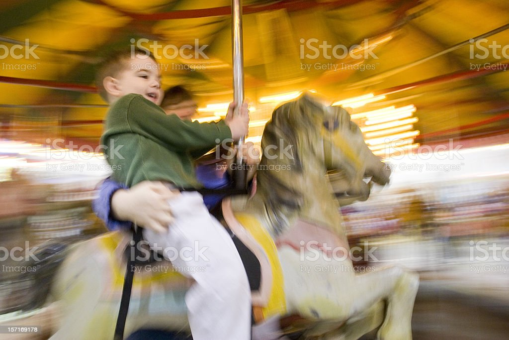 Boy on a carousel with motion blur stock photo