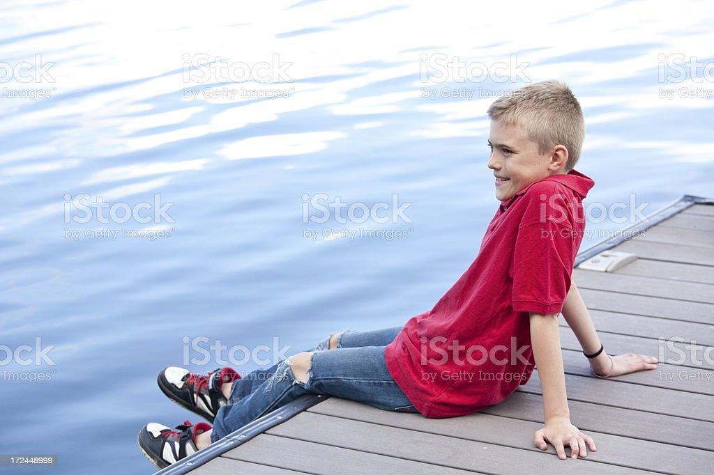 Boy On A Dock royalty-free stock photo