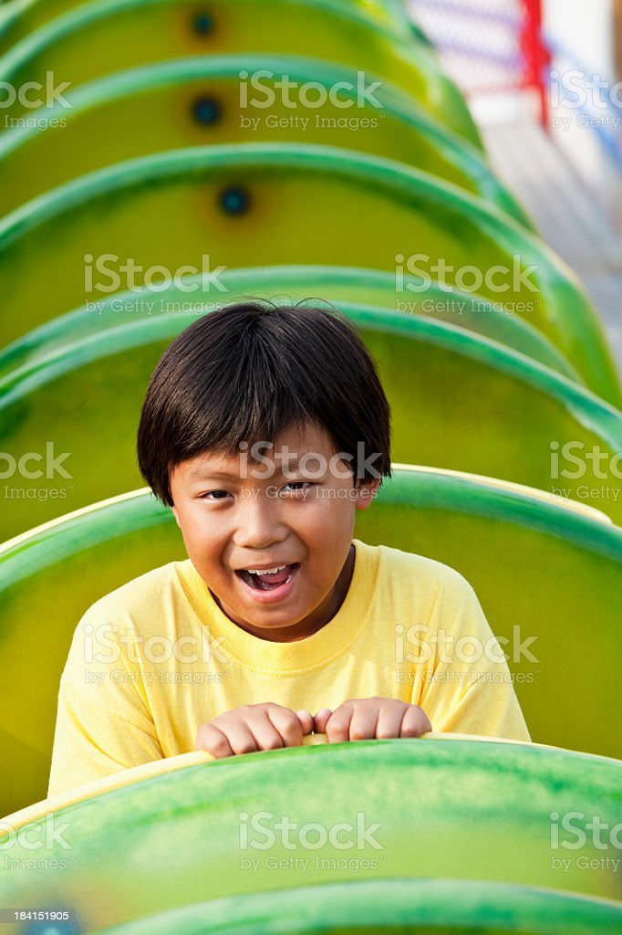 Boy on a roller coaster royalty-free stock photo