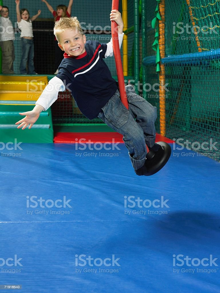 Boy on a swing royalty-free stock photo