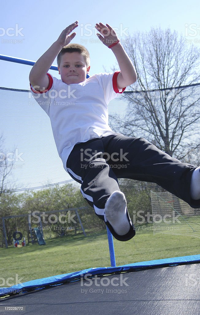 Boy on a Trampoline royalty-free stock photo