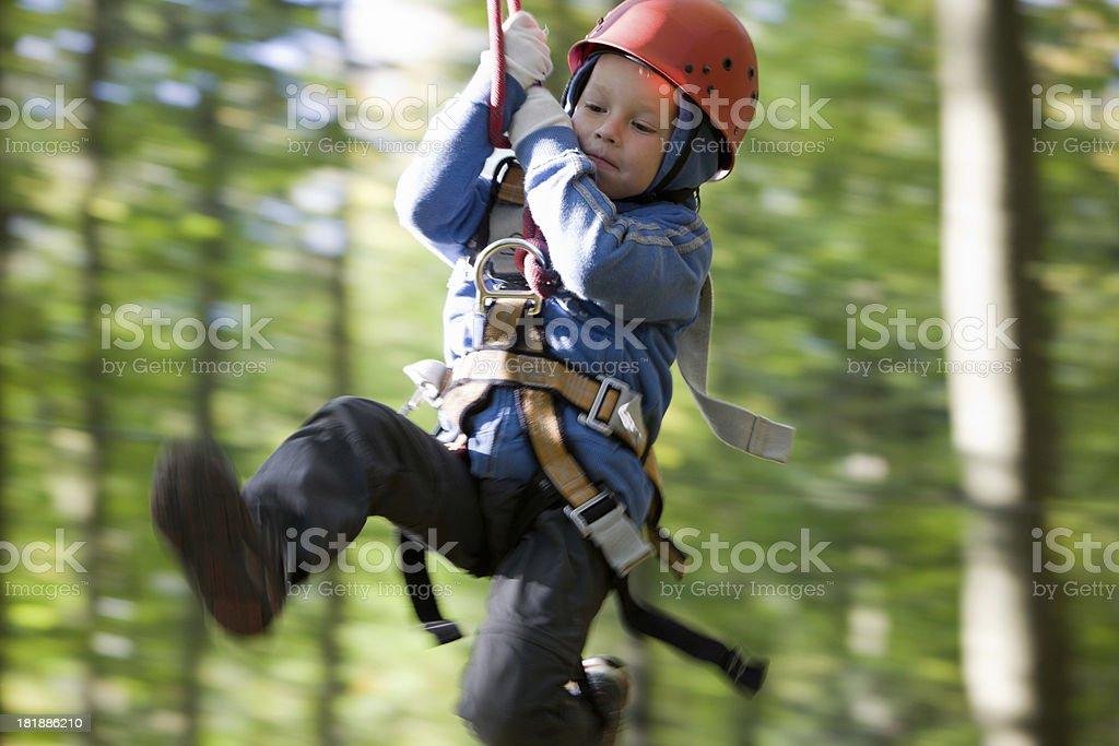 Boy on a Zip-line stock photo