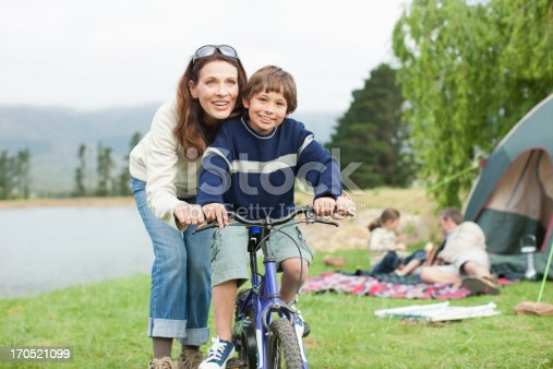 istock Boy on bicycle while on family camping trip 170521099