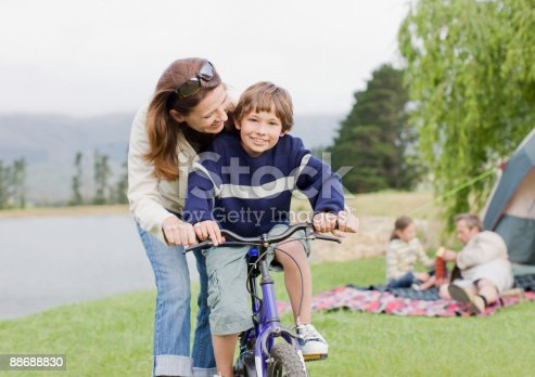 istock Boy on bicycle while on family camping trip 88688830