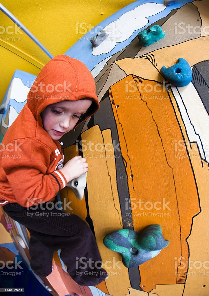 Boy on climbing wall royalty-free stock photo