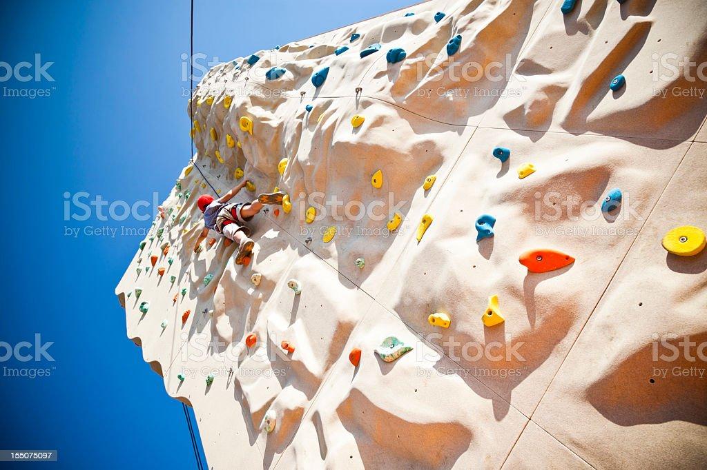 Boy on climbing wall royalty-free stock photo