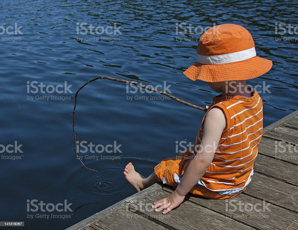 Boy on dock stock photo