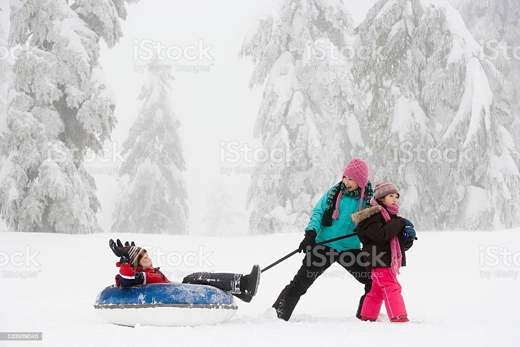 Boy on inflatable toboggan stock photo
