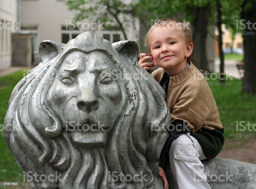 boy on lion royalty-free stock photo