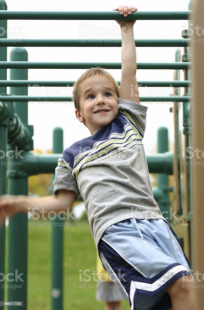 Boy on Monkey Bars royalty-free stock photo