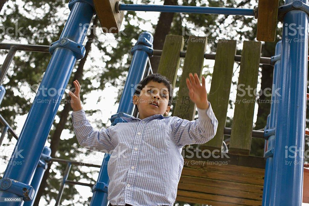 Chłopiec na plac zabaw Plac zabaw zbiór zdjęć royalty-free