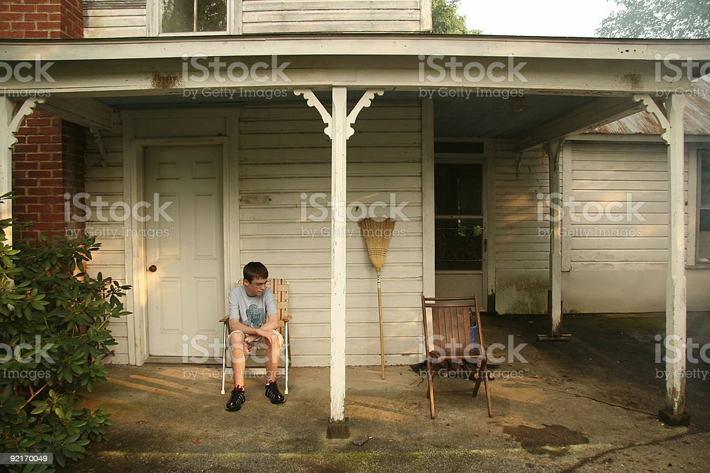 Boy on Porch royalty-free stock photo