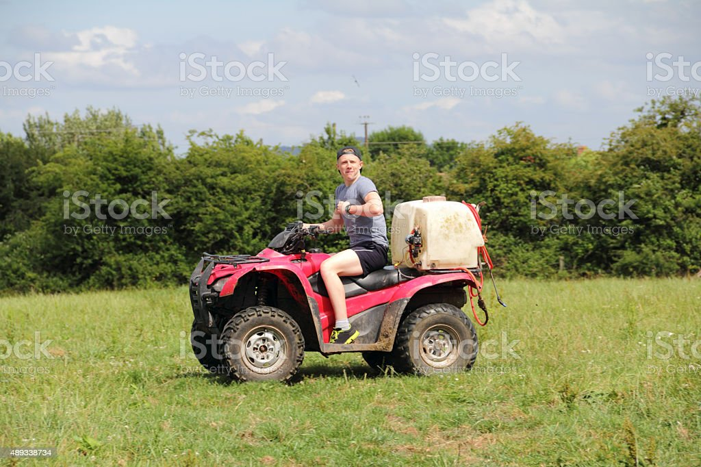 boy on quad stock photo