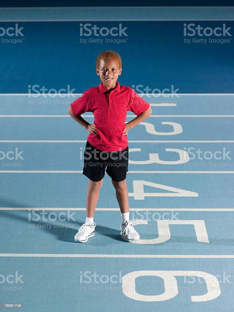 Boy on race track 免版稅 stock photo