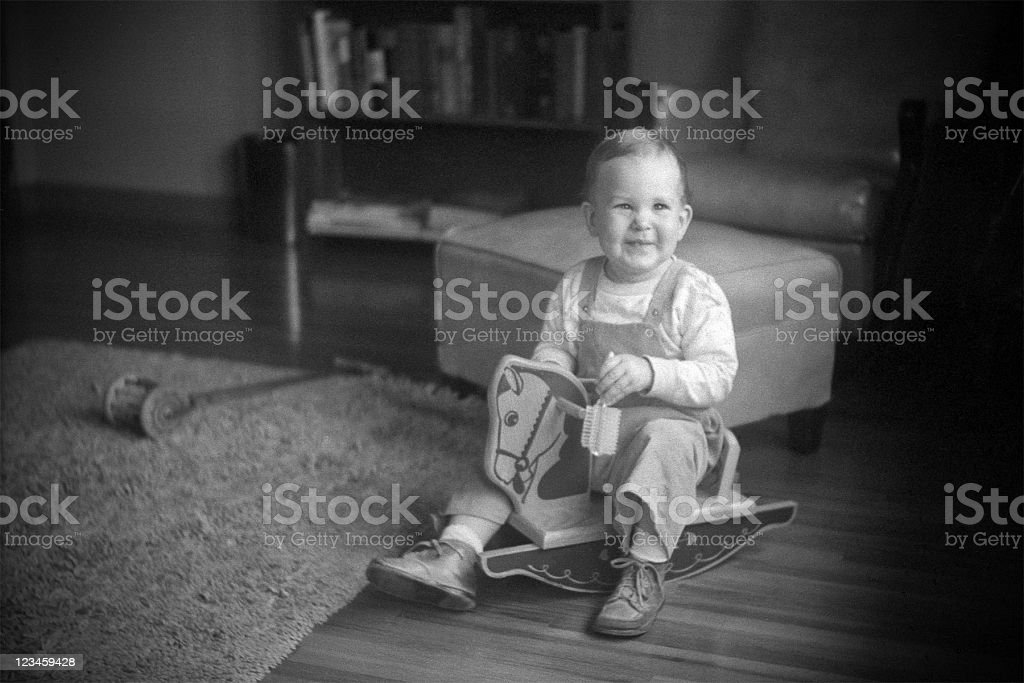 boy on rocking horse 1951, retro stock photo