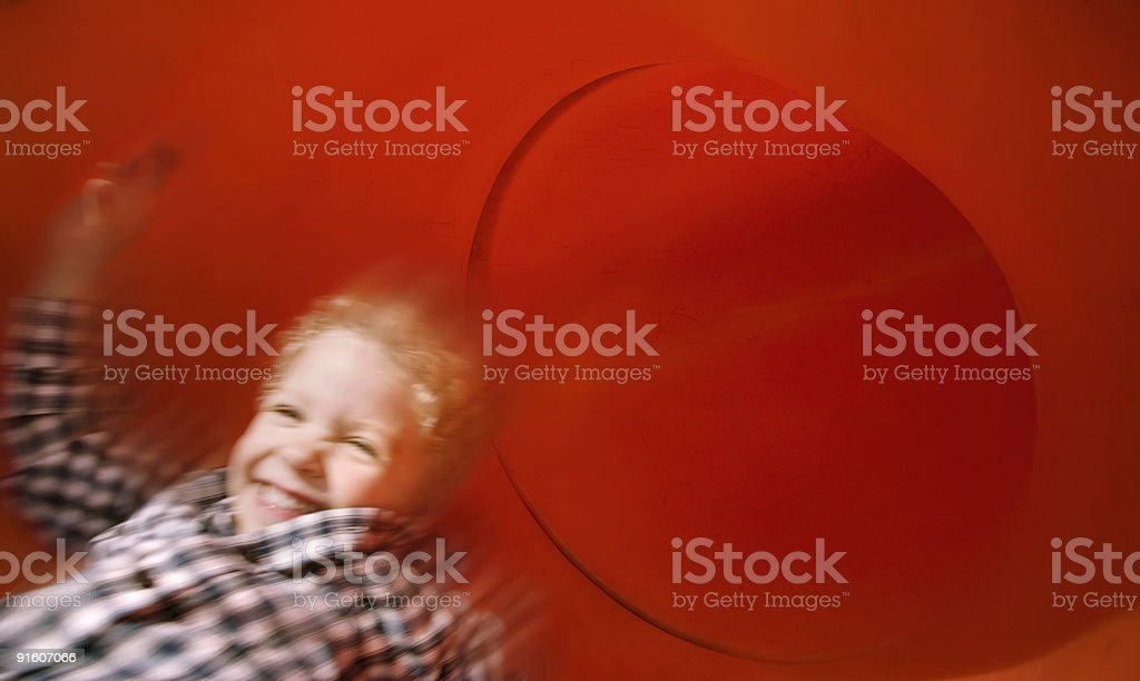 Boy on slide in motion royalty-free stock photo