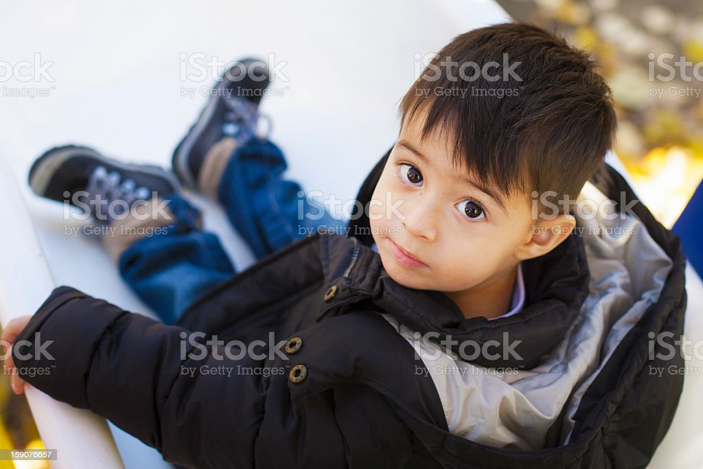 Boy on slide royalty-free stock photo
