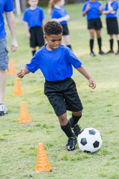 Boy on soccer team practicing stock photo