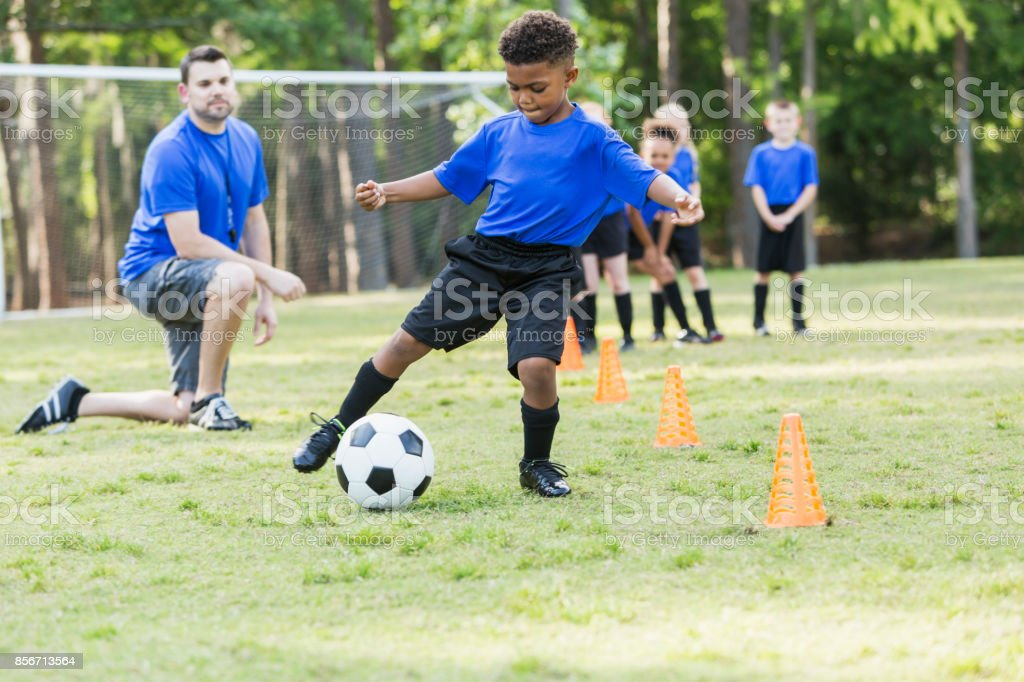 Boy on soccer team practicing stock photo
