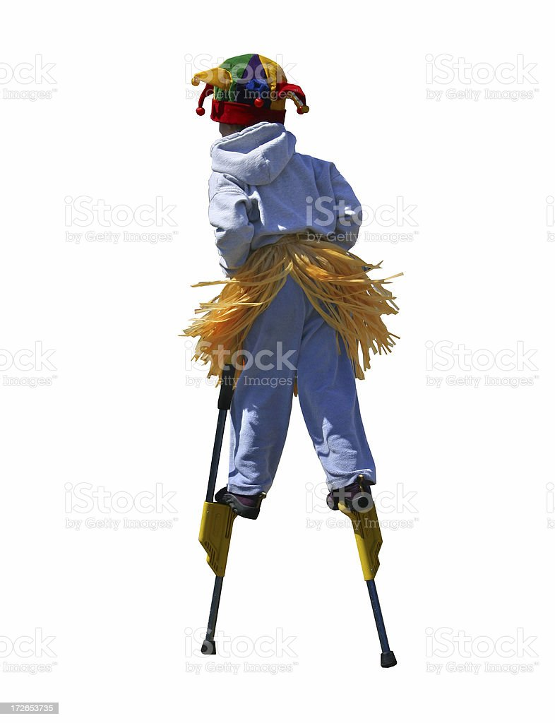 Boy On Stilts With Clipping Path stock photo