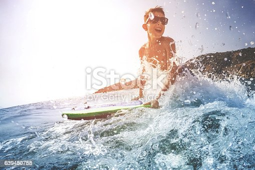 istock Boy on surfboard 639480788