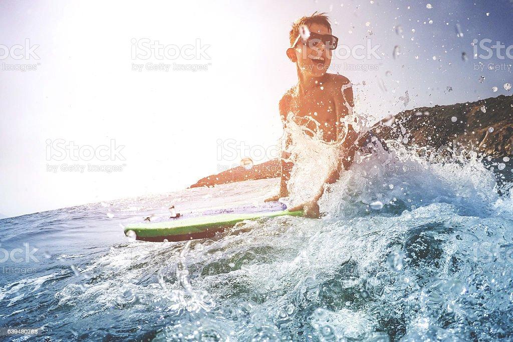 Boy on surfboard stock photo