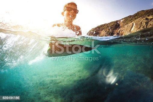 Photo of boy on surfboard