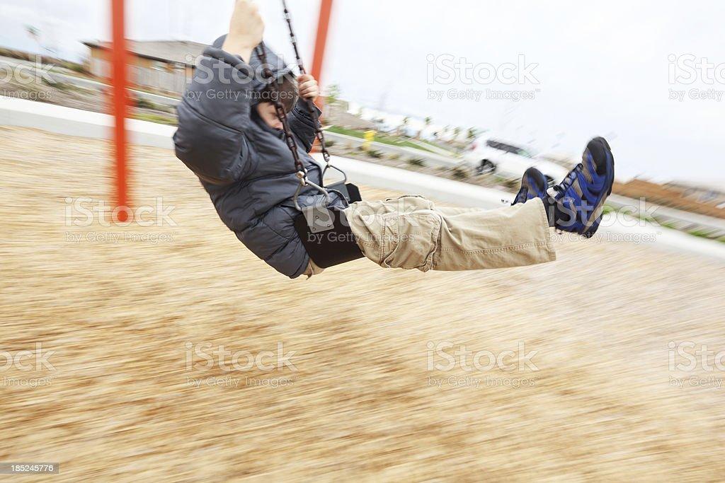 Boy on Swing royalty-free stock photo