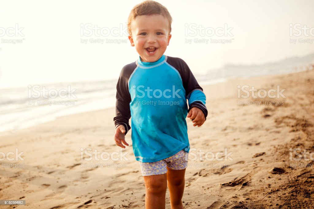 Boy on the beach stock photo