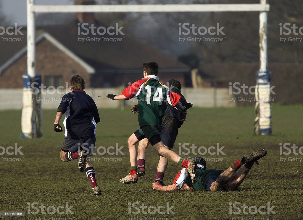 Boy on the ground in a rugby game stock photo