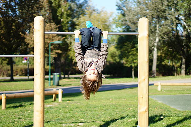 boy on the high bar - horizontal bar stock photos and pictures