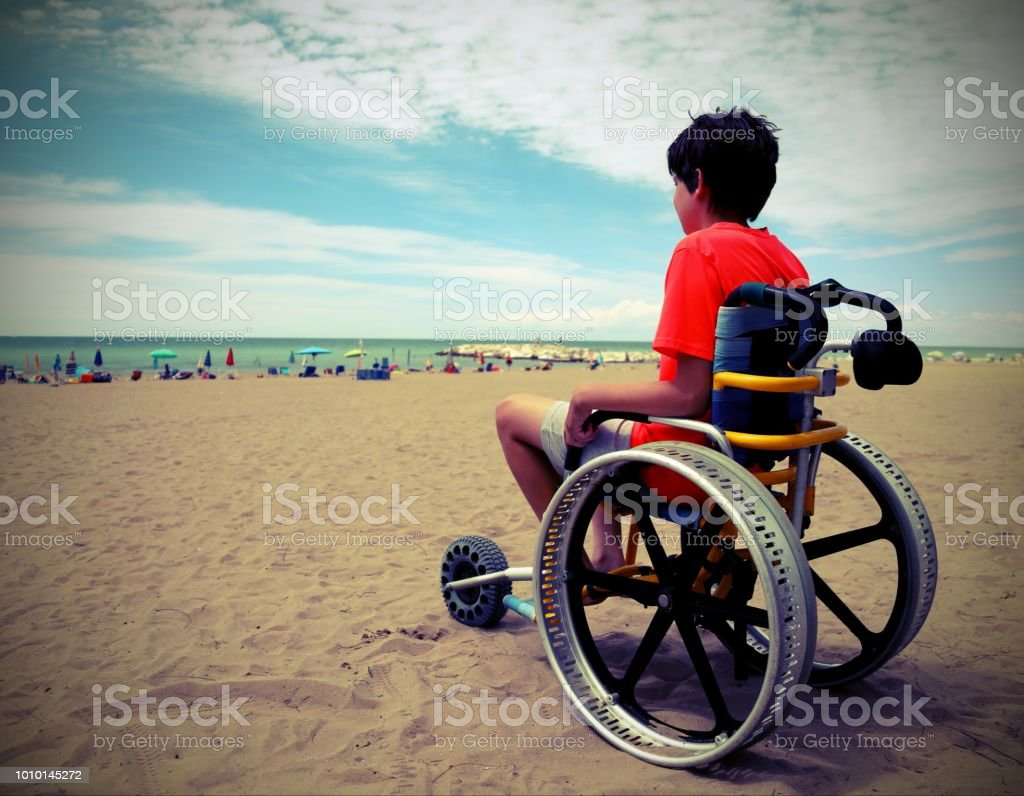 boy on the special wheelchair with aluminum alloy wheels with vi stock photo