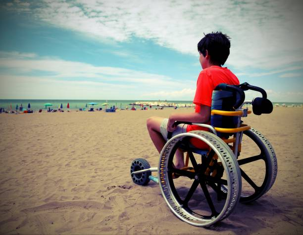 boy on the special wheelchair with aluminum alloy wheels with vi young boy with t-shirt sitting on the special wheelchair with aluminum alloy wheels with vintage effect in summer als stock pictures, royalty-free photos & images