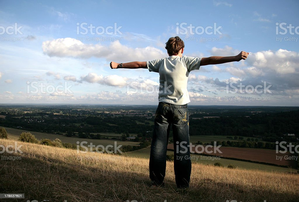 Boy on the top of hill stock photo