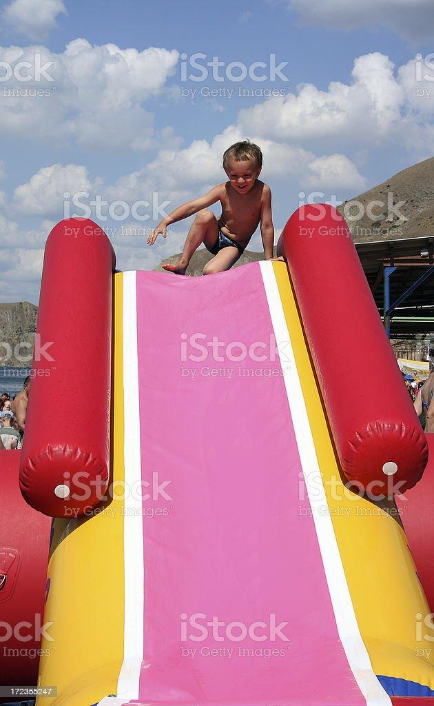 Boy on waterslide royalty-free stock photo