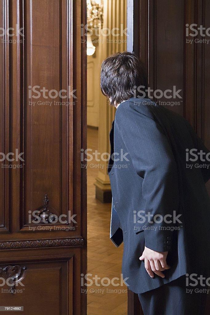 Boy opening door royalty-free 스톡 사진