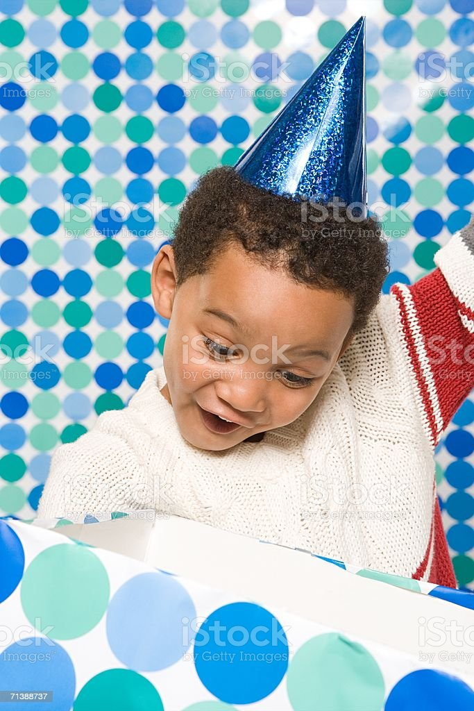 Boy opening present royalty-free stock photo