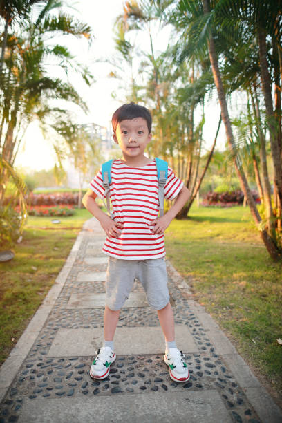 Boy outdoor with books stock photo