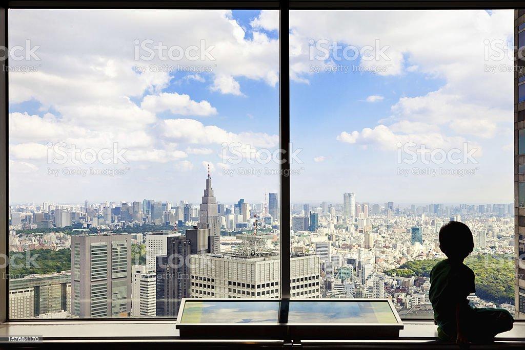 Boy Over Tokyo royalty-free stock photo