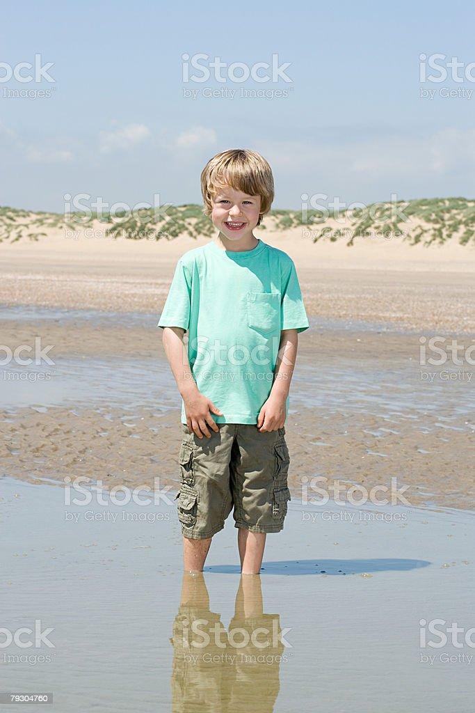 Boy paddling royalty-free stock photo