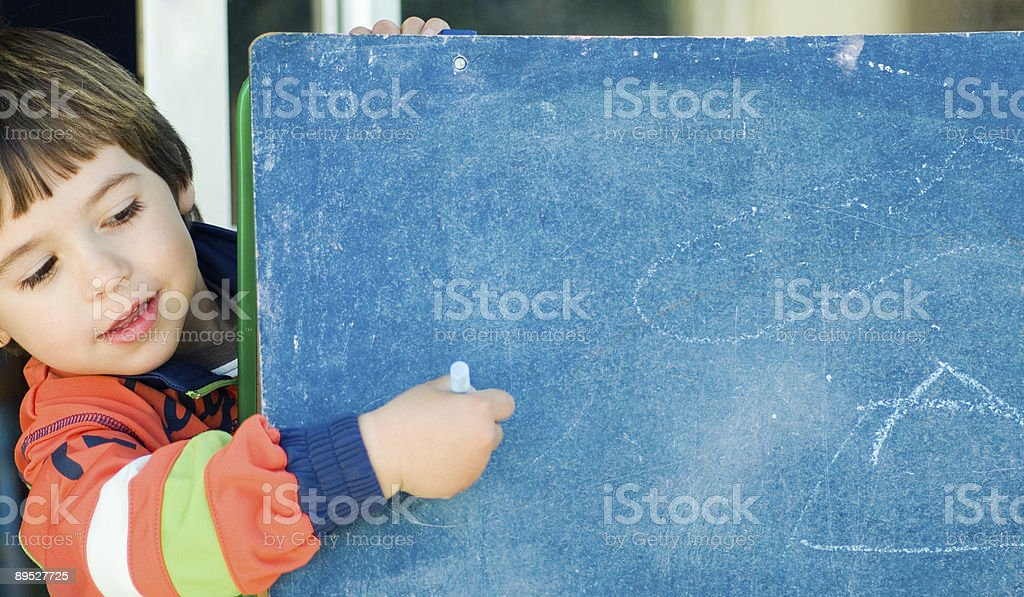 boy painting in a blackboard royalty-free stock photo